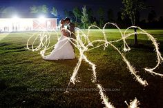 What a fun photo with a dreamy Cinderella like Sparkler photo. The Keeler Property Wedding in Jacksonville, Florida. They have a big red barn for receptions and a nice covered bridge for ceremonies. Christy Whitehead photography. Jacksonville, Florida based wedding, engagement and family photographer. Destination weddings.