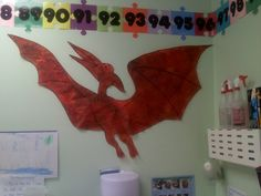 Preschool Dinosaur Bulletin Boards | Why not create a world of dinosaurs in your room! Use an overhead ...