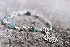 Aqua Blue Bracelet With Snowflake Charm by ClareyfairyCreations, £6.50
