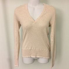 Oatmeal Colored Lightweight Hooded Sweater Comfortable and versatile, this oatmeal colored hooded sweater is a staple for anyone's closet. Size medium, but it will work nicely as a looser fit sweater on a Small as well. Old Navy Sweaters V-Necks