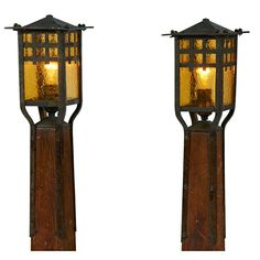 """Gustav Stickley, Attribution, newel posts, pair, Eastwood, NY, oak, hammered amber glass, copper, unsigned, mounted on a later wood base, 11""""w x 9""""d x 29.5""""h."""