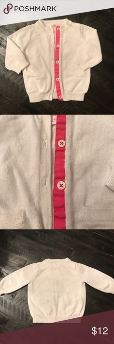 Off white Cardigan Cute off white cardigan with hot pink detail behind front buttons is by genuine baby from OshKosh. It's sized for 9 month and has two usable front pockets. In great condition! Osh Kosh Shirts & Tops