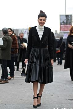 AiB:  V-neck velvet cardie, intricate pleated leather skirt, round toed heels with shapely ankle straps and a hint of white: roll top sweater and purse ... lady in black a la '50s silhouette ... classic   image from TheUrbanSpotter