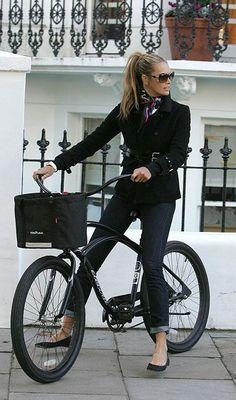 Street style: Elle Macpherson black trench, denim jeans & ballet flats