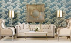 Sophisticated and Timeless: This Chesterfield sofa complete with a Greek key nailhead design is a versatile and elegant enough for any style. Paired here with Asian accents, a window pane mirror and pagoda base lamps add a touch of the exotic, while subtle Japanese-inspired wallpaper reminiscent of clouds infuses the room with airy elegance. $1,999.00