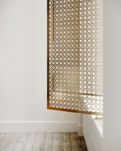 metal mesh screens in brass add a lux appeal to the neutral organic space