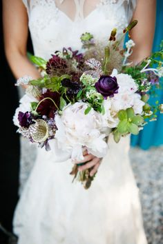Pretty pops of burgundy and purple in a stunning rustic bouquet