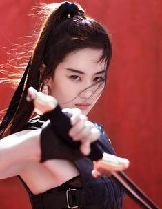Disney announced that it will cast Chinese actress Crystal Liu Yifei as the lead of 'Mulan.' We take a look at Liu's rise to fame and why she's perfect for the role. Poses, Warrior Girl, Chinese Actress, Beautiful Asian Girls, Beautiful Film, Asian Woman, Rockabilly, Asian Beauty, Rock And Roll