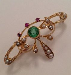 "Sufragette Art Nouveau 15K Yellow Gold, Green Garnet, Amethysts & Seed Pearls Brooch, the Colors of the Stones, Green, White and Violet, Extend to Mean ""Give Women the Vote""."