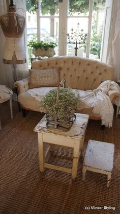 Cosy corner with vintage stripped and painted sofa
