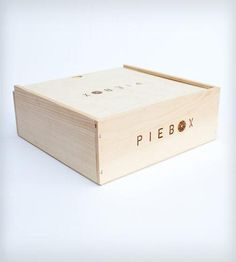 """Reusable raw pine box designed to safely transport pie. Whether you're driving, biking, taking the bus, or just walking, PieBox will keep your pie safe and intact. Every PieBox is handcrafted and can be personalized for an extra surcharge. PieBox measures 11.5"""" x 11.5"""" x 4.25"""" (10.75"""" x 10.75"""" x 3.5"""" inside) and accommodates up to a 9"""" deep-dish pie. Starting at $55"""