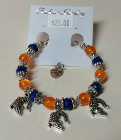 Check out this item in my Etsy shop https://www.etsy.com/listing/233942106/orange-and-blue-gator-charm-bracelet