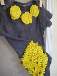 E'd be so cute in this ruffle bum onsie ($20 amandavoelker etsy.com)