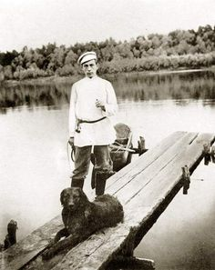 Sergei Rachmaninov with his dog Levko on banks of the Hopyor river, 1899.
