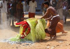 Walking on fire during Theyyam, India by Eric Lafforgue, via Flickr
