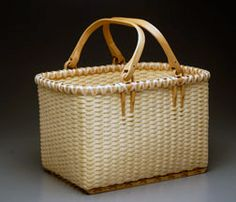 Alice Ogden Black Ash Baskets of great beauty, made from fresh wood.  http://www.aliceogden.com/products/rectangular-baskets#    And I have this one.