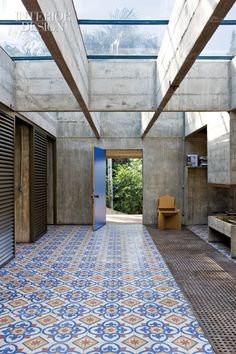 Foyer. Portuguese-style patterned cement tiles. Brutalist style home in Brazil.  Architect: Paulo Mendes da Rocha.