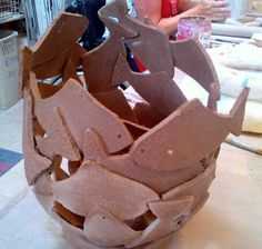 Hand built vessel constructed with paper clay fish patches by Emily O'Byrne at Dublin based Weekend Ceramic Course. Later electric fired to 1260°C (Cone 8).  www.ceramicforms.com