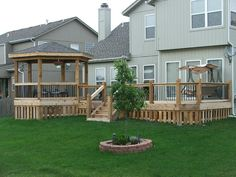 Gazebo and open cedar deck with shadow box skirting; built by DW Elite Decks in Leawood, Kansas