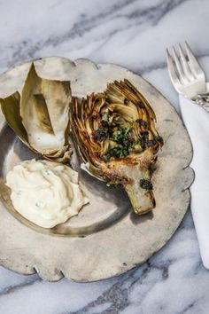 GRILLED ARTICHOKE WITH LEMON GARLIC AIOLI. 20 Ketogenic Recipes to Make on the Grill This Summer #purewow #food #grilling #cooking #recipe #garlicaioli #artichokes #grilledrecipes #vegetarianrecipes