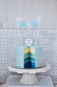 Love the different colors of the cake! This for a too cake and the different colored cupcakes to go along with it