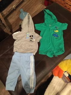 Precious Mickey Mouse tracksuit and green onesie with fish detail.