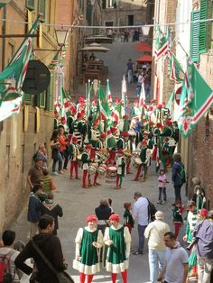 We watched as the contradaioli, (the district inhabitants) gathered, and the boys and young men, dressed in the traditional white, green and red costumes, practiced their flag waving and seemingly incessant drumming.