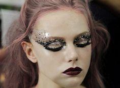 glittering lids + burgundy lips.