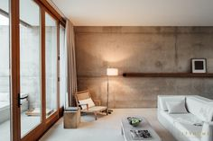Amangiri guest room, cement walls, modern furniture, neutral colors, private patio, large glass doors, cityhomeCOLLECTIVE