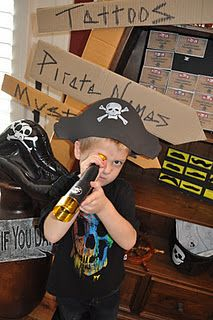 Pirate birthday party... i like the signs made out of card board