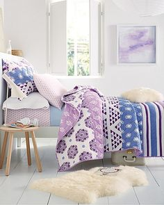 Imaginative and artsy, our hand-quilted Zhora bedding makes a bold statement. Pieced from pretty patterns and painterly stripes that range from lovely lavenders to vivid violets.