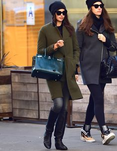 Irina Shayk elevated the casual winter hat with a tailored olive green coat, knee-high boots, and a Birkin.