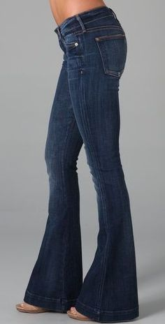 Love the color of these flat and can wear to work since they aren't distressed. Jiselle Flare Jean In Deep Blue