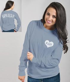 HEART LONG SLEEVED TEE SHIRT! Soft, comfortable long-sleeved tee shirt has elongated KDP Greek letters on the back and a small heart with KDP Greek letters on the left front.