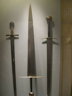The sword in the middle is an absolutely classis type XVIIIc.  Many of these are found at the arsenal of Alexandria.  I would love to add one of these to my collection someday.