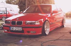 Hellrot BMW e36 compact on custom wheels from OEM BMW Styling 29 (BBS RC) wheels