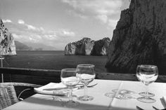 Josef Koudelka ITALY. Capri. 1999. I like the simplicity of this image with the beatiful background of the sea and mountains. I like the composition of this image the close up of the tables and glsses incoporating with the scene in the background. pictured in black and white makes it more effective and adds a sense of sophistication.