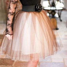 Lovely DIY Tulle Skirt. I've never thought about making anything with tulle. But it could very well be something I could do. This skirt is adorable!