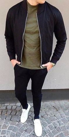 Men Clothing Minimal style inspiration with a black bomber jacket olive t shirt black denim with white sneakers in this street style look Men Clothing Source Casual Mode, Men Casual, Casual Styles, Casual Fall, Mode Outfits, Casual Outfits, Mode Man, Black Bomber Jacket, Bomber Jacket Outfit