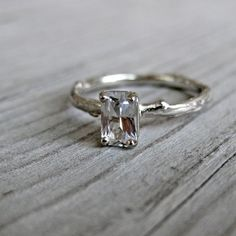 Emerald cut white sapphire twig ring. I LOVE THIS STYLE!!!!