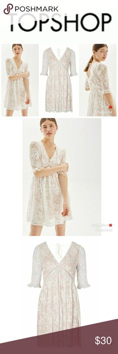 Topshop Pleat Lace Trim Flippy Dress Keep your look romantic in this stunning pleated lace flippy dress with contrast colour lining. Add strappy sandals and a metallic clutch for a show stopping look. 100% Polyester. Machine wash. Topshop Dresses Mini
