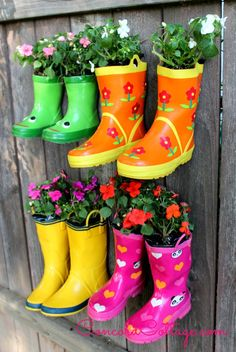 You can plant a Rainboot Garden on your fence.  www.ConcordCottage.com #Garden #Flowers