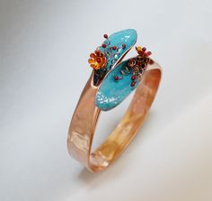 From copper piping, wire, and enamel, we will create a vibrant bracelet.