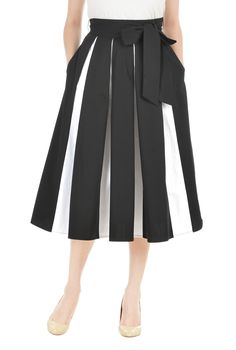 Our cotton poplin skirt is cinched at the waist with a removable sash tie belt and flared out with colorblock inset box pleats.