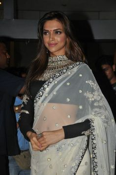 Deepika in a white Sabyasachi embellished saree.