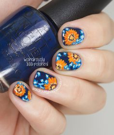 Blue and Orange Daisy Nail Art