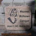 engraved portrait on granite grave marker