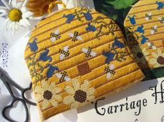 cross stitch ornament in the shape of a beehive with specialty stitches-darling!