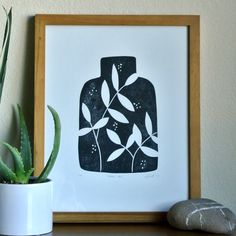 "This is an original linocut print titled ""VESSEL NO. 1"".  I collect vessels and vases of all sizes and shapes, and decided to create a series of linocut prints inspired by my collection and love of simple botanical shapes. This is the first in the series. Printed in black eco-friendly ink. Open Edition. Hand printed onto acid free paper.  Paper Size: 11 X 14 in. Image Size: 8 X 10 in.  This linocut started out as a drawing which was transferred to a piece of artists linoleum. The image was…"