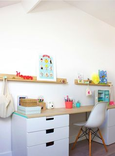Add even more storage with floating shelves above the desk to pile on a few books, framed art or even pegs to keep your bag off the floor.
